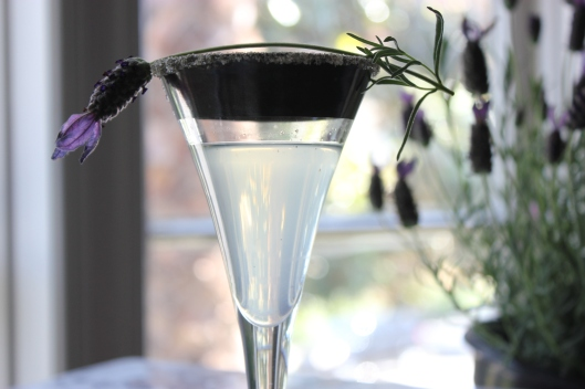 Vegan Lavender Martini with lavender sprig for garnish